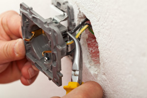 Electricial Services: Installing Wires Into Electrical Outlet