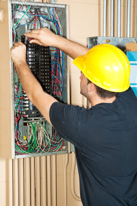 Electrical Services: Electrician Working On Electrical Panel